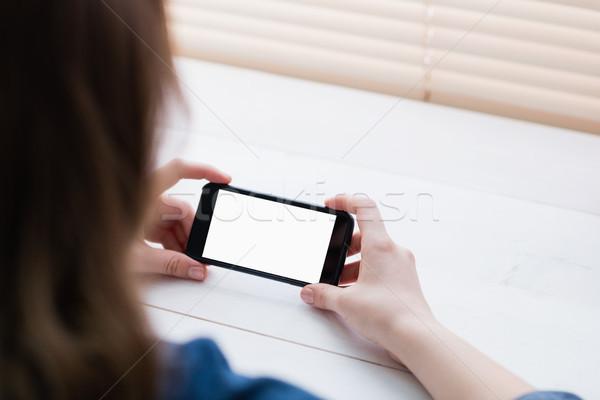 Close up view of businesswoman using her phone Stock photo © wavebreak_media