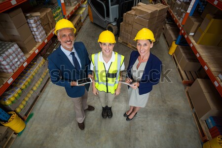Portrait of warehouse manager and workers Stock photo © wavebreak_media