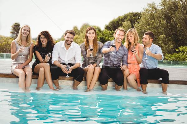 Gençler oturma yüzme havuzu içme Stok fotoğraf © wavebreak_media