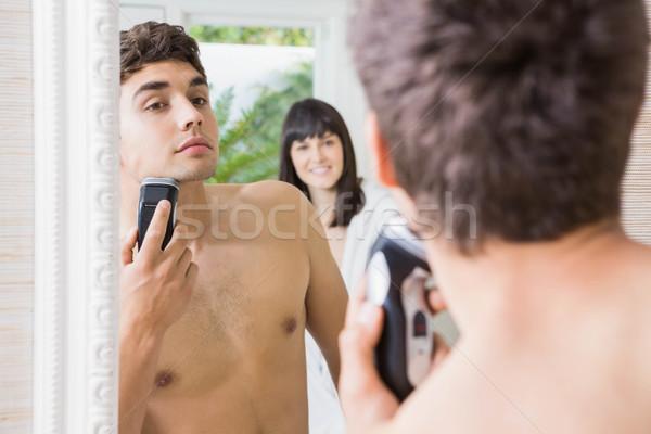 若い男 ミラー 電気 反射 家 女性 ストックフォト © wavebreak_media