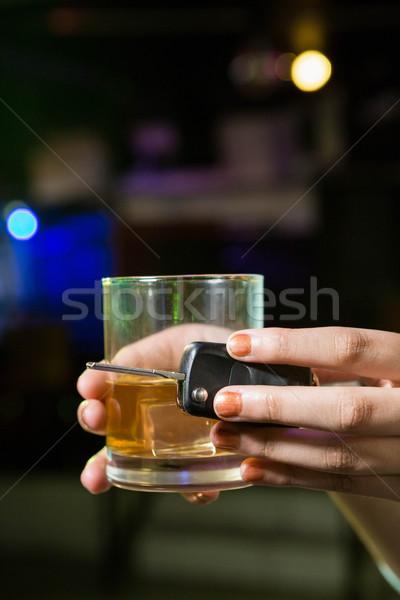 Femme verre whiskey clés de voiture bar Photo stock © wavebreak_media
