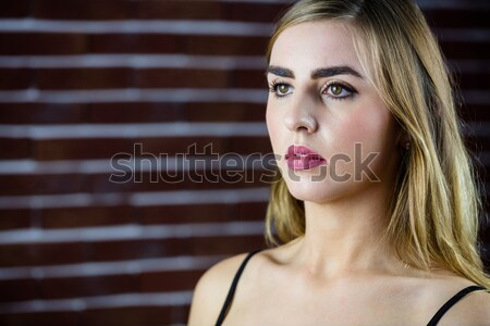 Güzel sarışın kadın gün tuğla duvar duvar Stok fotoğraf © wavebreak_media