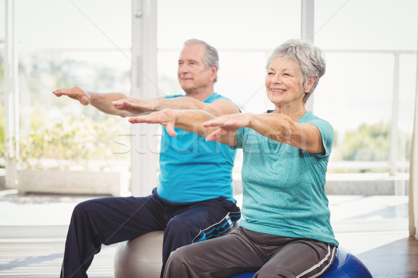 Happy senior couple performing exercise Stock photo © wavebreak_media