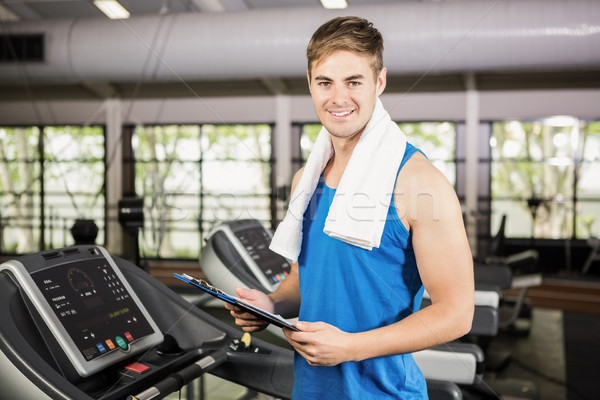 Portrait of trainer holding clipboard on treadmill Stock photo © wavebreak_media