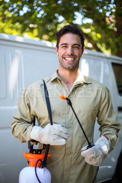 Happy worker with pesticide sprayer  Stock photo © wavebreak_media