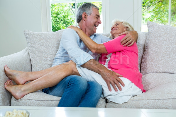 Romantic senior couple sitting on sofa Stock photo © wavebreak_media