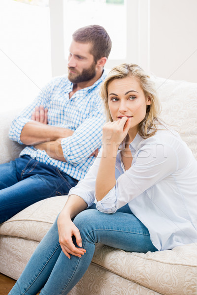 Young couple ignoring each other in living room Stock photo © wavebreak_media