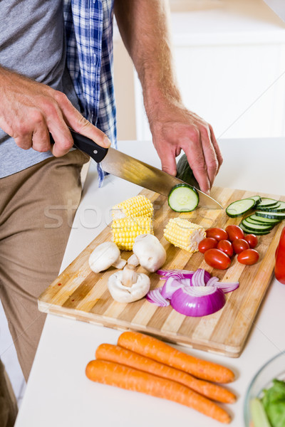 Mid-section of man chopping vegetable in kitchen Stock photo © wavebreak_media