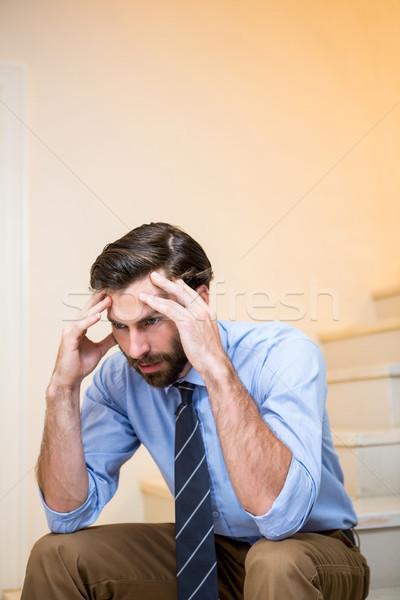 Worried man sitting on stairs Stock photo © wavebreak_media
