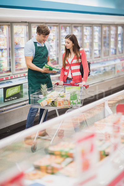 A man grocer advising his customer Stock photo © wavebreak_media