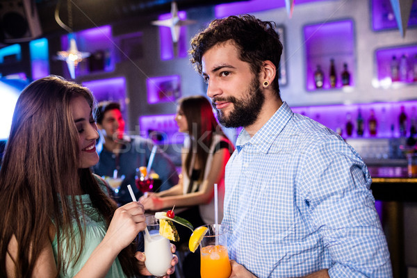 Lächelnd Freunde Cocktail bar counter Party Stock foto © wavebreak_media