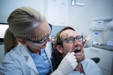 Foto stock: Femenino · optometrista · gafas · jóvenes · paciente · oftalmología
