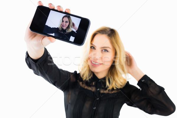 Mosolygó nő fotó mobiltelefon fehér gyönyörű nő nő Stock fotó © wavebreak_media