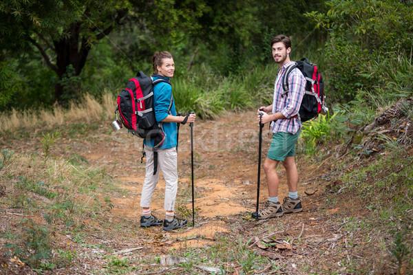 Retrato caminante Pareja pie senderismo polo Foto stock © wavebreak_media