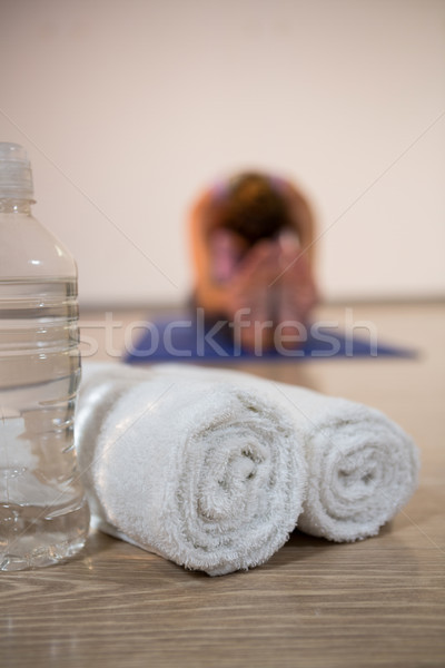 Rolled towels and water bottle in fitness studio  Stock photo © wavebreak_media