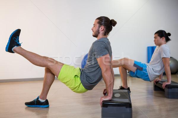 Due uomini aerobico esercizio fitness studio donna Foto d'archivio © wavebreak_media