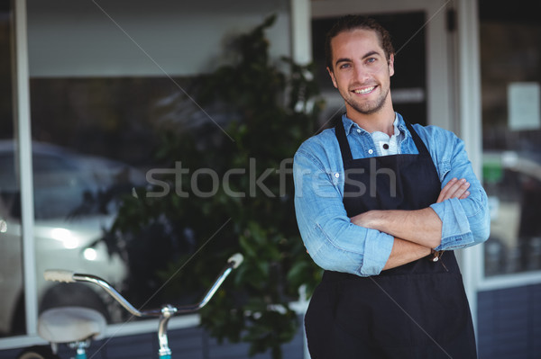 Waiter standing with arms crossed outside the cafe  Stock photo © wavebreak_media