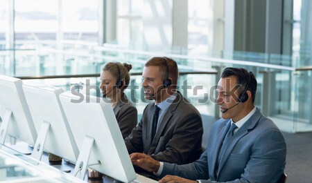 Stock photo: Confident businesspeople standing in office