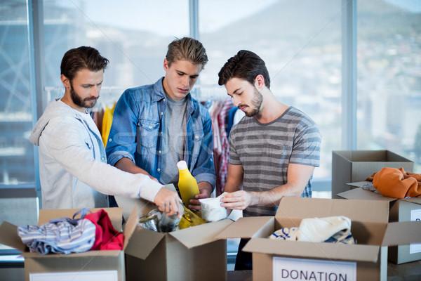 Kreatív üzleti csapat ruházat adomány doboz iroda Stock fotó © wavebreak_media