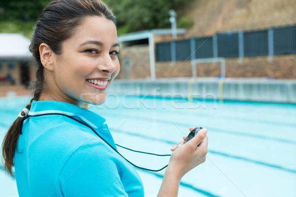 Portrait of swim coach holding stopwatch near poolside Stock photo © wavebreak_media