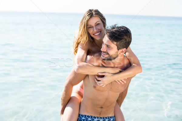 Man piggybacking girlfriend on shore at beach Stock photo © wavebreak_media