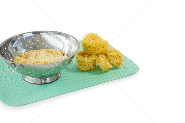 Close up of pasta in colander with tagliolini on place mat Stock photo © wavebreak_media