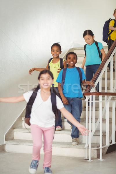 Happy pupils walking down the stairs Stock photo © wavebreak_media