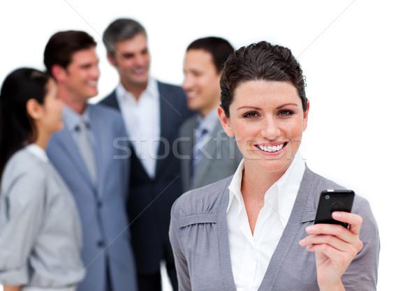 Karizmatikus menedzser telefon csapat fehér üzlet Stock fotó © wavebreak_media