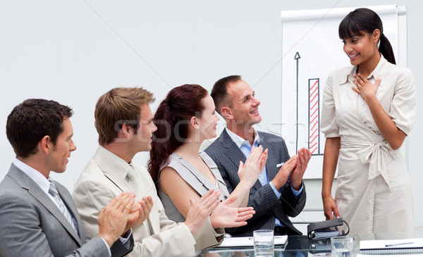 Business people applauding a colleague after giving a presentati Stock photo © wavebreak_media