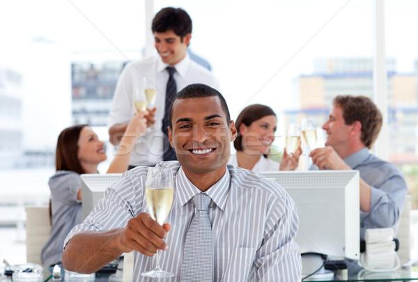 Fortunate business team drinking champagne Stock photo © wavebreak_media
