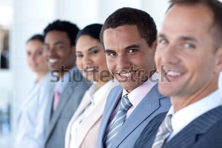Több nemzetiségű mosolyog üzleti csapat ül csetepaté iroda Stock fotó © wavebreak_media
