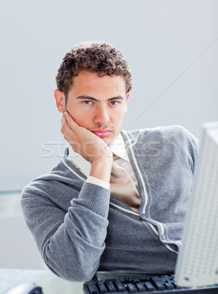 Stock photo: Portrait of a young businessman getting bored at work