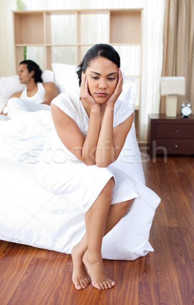 Young couple sitting on the bed separately  Stock photo © wavebreak_media