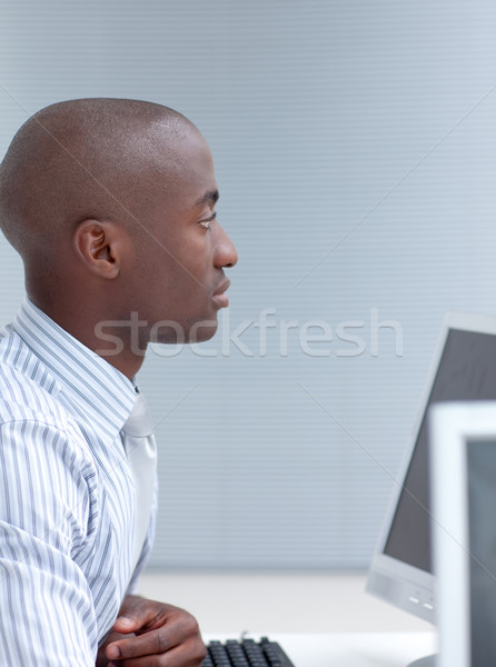 Businessman working in office with a computer Stock photo © wavebreak_media