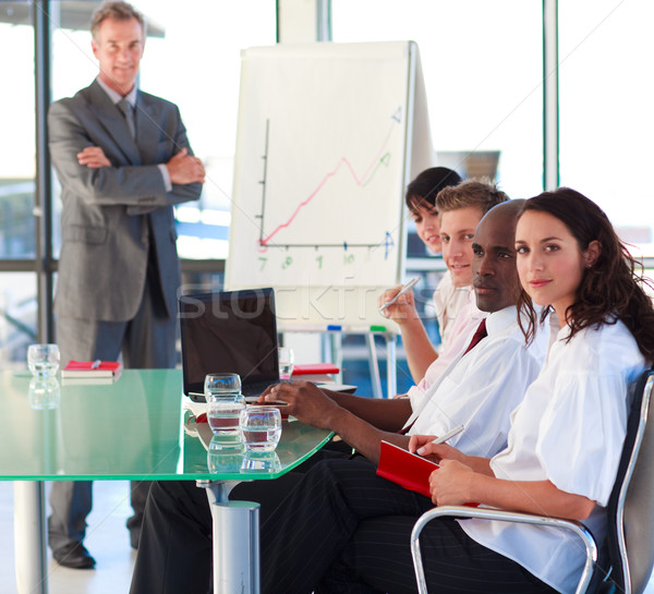Mature manager in a presentation with folded arms Stock photo © wavebreak_media