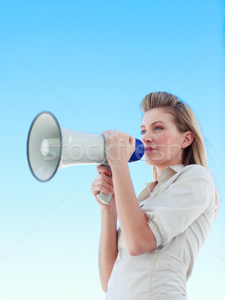 Attractive businesswoman shouting in a megaphone Stock photo © wavebreak_media
