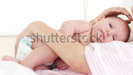 Newborn baby with his mother in bed Stock photo © wavebreak_media