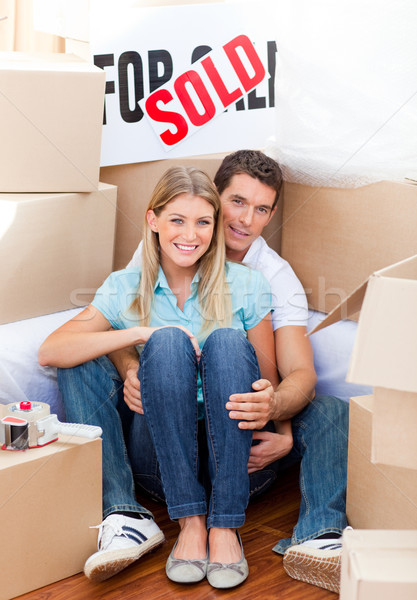 Intimate couple embracing after move in at home Stock photo © wavebreak_media