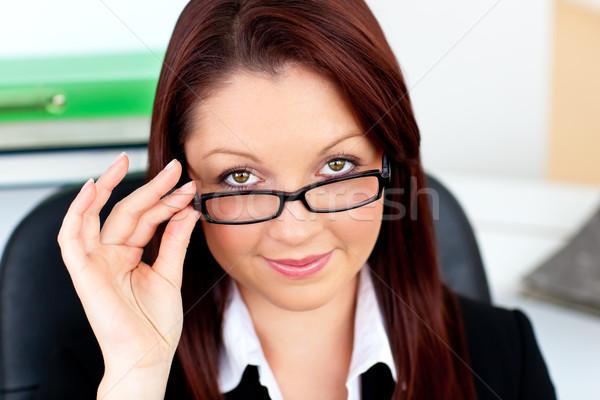 Bájos üzletasszony tart szemüveg iroda nő Stock fotó © wavebreak_media
