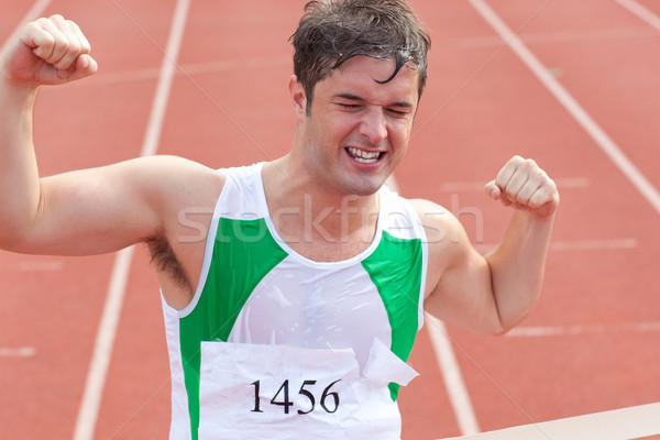 Ecstatic sprinter showing expression of victory in front of the arrival line in a stadium Stock photo © wavebreak_media