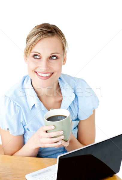 Glowing businesswoman drinking coffee smiling at the camera Stock photo © wavebreak_media
