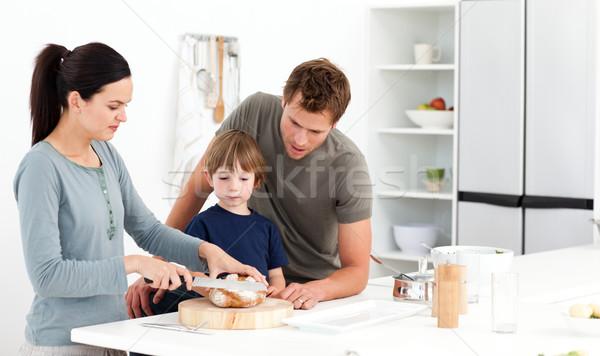 женщину хлеб сын муж Сток-фото © wavebreak_media