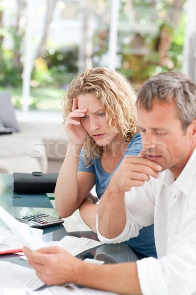 Desperate couple calculating their domestic bills Stock photo © wavebreak_media