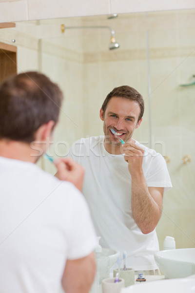 Man brushing his teeth Stock photo © wavebreak_media