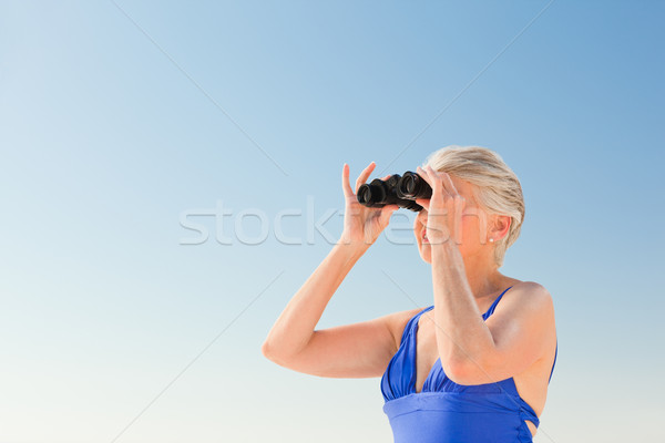 Senior woman bird watching at the beach Stock photo © wavebreak_media