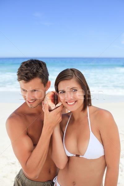 любителей прослушивании оболочки рук счастливым морем Сток-фото © wavebreak_media