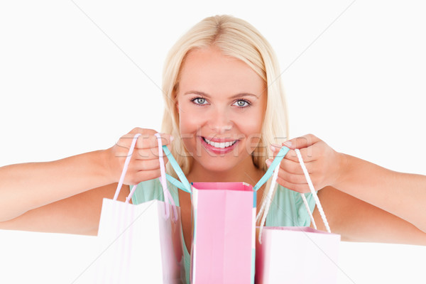 Happy woman with bags looking into the camera in a studio Stock photo © wavebreak_media