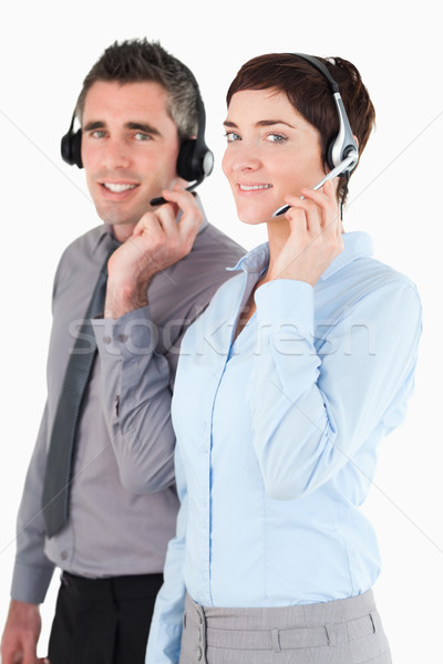 Portrait of operators speaking through headsets against a white background Stock photo © wavebreak_media