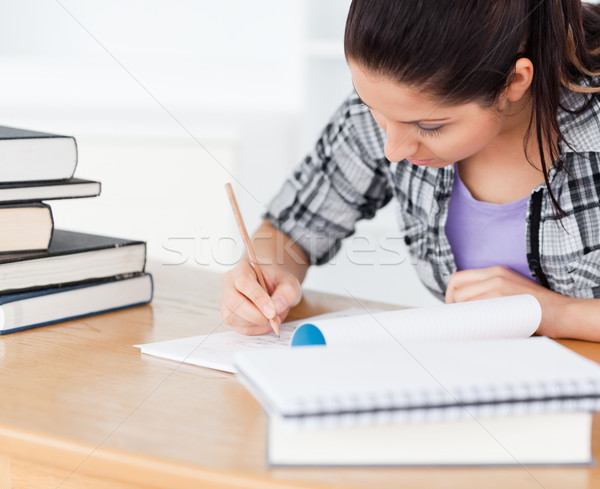 Stock photo: A young student is learning between books