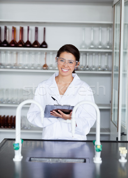 Portrait of a student in science writing on a clipboard in a laboratory Stock photo © wavebreak_media